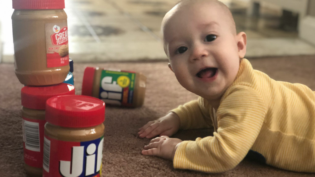 Benjamin Nagy, son of HNB VP, Elizabeth Nagy, is ready to make his peanut butter donation.